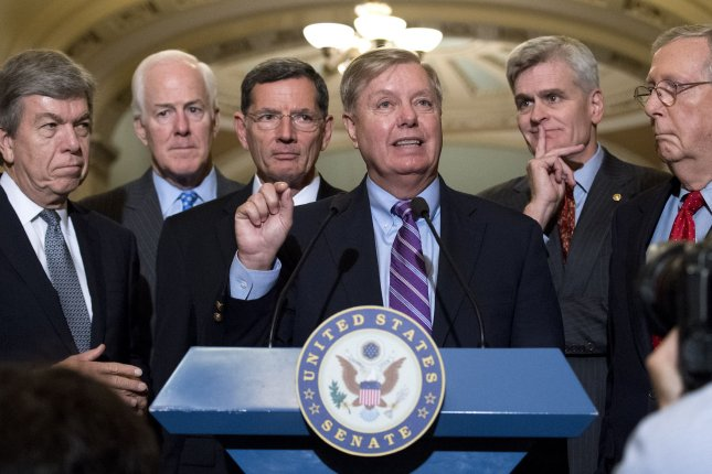 Sen. Lindsey Graham, R-S.C., (C) speaks on a healthcare bill, joined by fellow Republican Senators, on Capitol Hill Tuesday. Photo by Kevin Dietsch/UPI