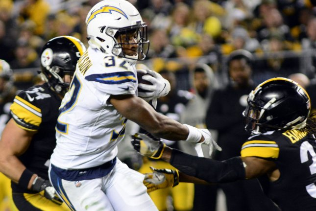 Los Angeles Chargers running back Justin Jackson dodges tackles during a game against the Pittsburgh Steelers at Heinz Field on December 2, 2018. Photo by Archie Carpenter/UPI