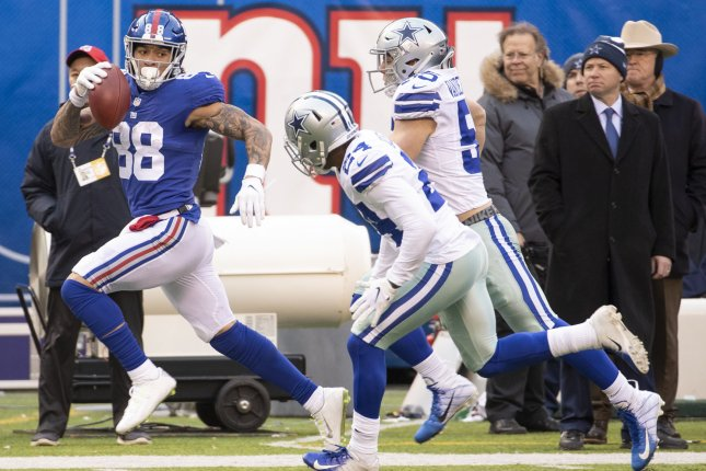 New York Giants tight end Evan Engram (L) had at least 100 receiving yards and a score in two of his first three games this season. File Photo by Chris Szagola/UPI