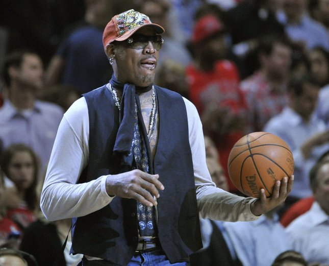 Former Chicago Bull Dennis Rodman brings out the game ball before game 2 of the NBA Eastern Conference Finals between the Miami Heat and the Chicago Bulls at the United Center in Chicago, May 18, 2011. UPI/Brian Kersey