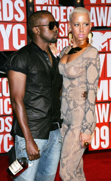 Kanye West and girlfriend Amber arrive for the MTV Video Music Awards at Radio City Music Hall in New York on September 13, 2009. UPI/Laura Cavanaugh