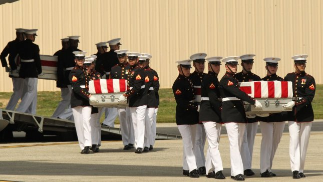 Transfer cases are carried during the Transfer of Remains Ceremony marking the return to the United States of the remains of the four Americans killed this week in Benghazi, Libya, at Joint Base Andrews near Washington, DC on September 14, 2012. UPI/Molly Riley/Pool
