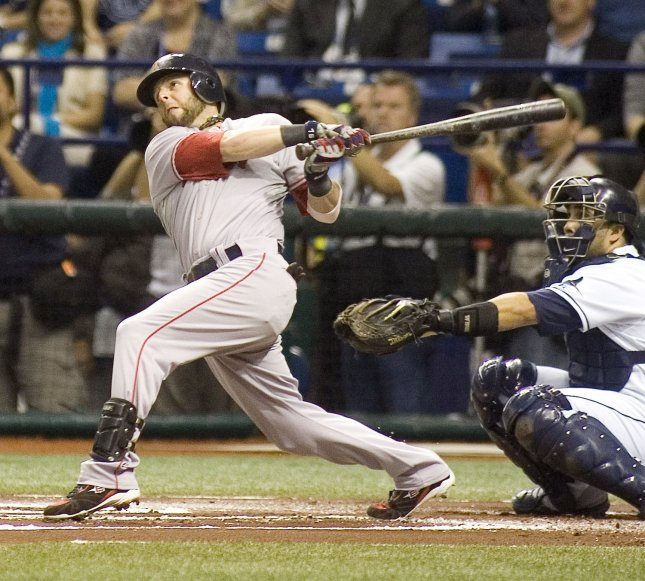 Boston Red Sox second baseman Dustin Pedroia, shown hitting a home run during the 2008 baseball playoffs, was voted the American League most valuable player, baseball officials announced Tuesday. (UPI Photo/David Mills)