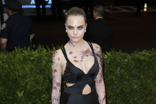 Cara Delevingne arrives on the red carpet at the Costume Institute Benefit at The Metropolitan Museum of Art celebrating the opening of China: Through the Looking Glass in New York City on May 4, 2015. File Photo by John Angelillo/UPI