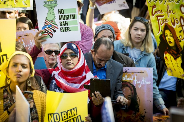 Pro-immigration activists attend a #NoMuslimBanEver rally in front of the White House on October 18. Photo by Pete Marovich/UPI