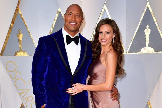 Dwayne Johnson (L) and Lauren Hashian. Johnson stars in the first trailer for Hobbs & Shaw alongside Jason Statham. File Photo by Kevin Dietsch/UPI