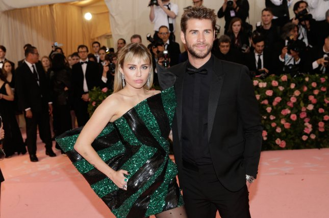 Miley Cyrus (L), pictured with Liam Hemsworth, voiced her love for Hemsworth on their 10-year anniversary as a couple. File Photo by John Angelillo/UPI