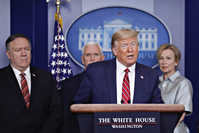 President Donald Trump speaks to reporters Friday during an update of the Coronavirus Task Force at the White House. Secretary of State Mike Pompeo is at left.  Photo by Al Drago/UPI