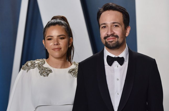 Hamilton creator Lin-Manuel Miranda (R) and his wife Vanessa Nadal arrive for the Vanity Fair Oscar party on February 9. Hamilton has caused downloads of Disney+ to rise. File Photo by Chris Chew/UPI