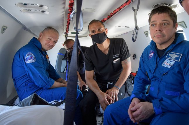 NASA astronauts Douglas Hurley (L) and Bob Behnken (R) prepare to depart their helicopter at Naval Air Station Pensacola after the duo landed in their SpaceX Crew Dragon Endeavour spacecraft in the Gulf of Mexico off Pensacola, Fla., on Sunday. NASA Photo by Bill Ingalls/UPI