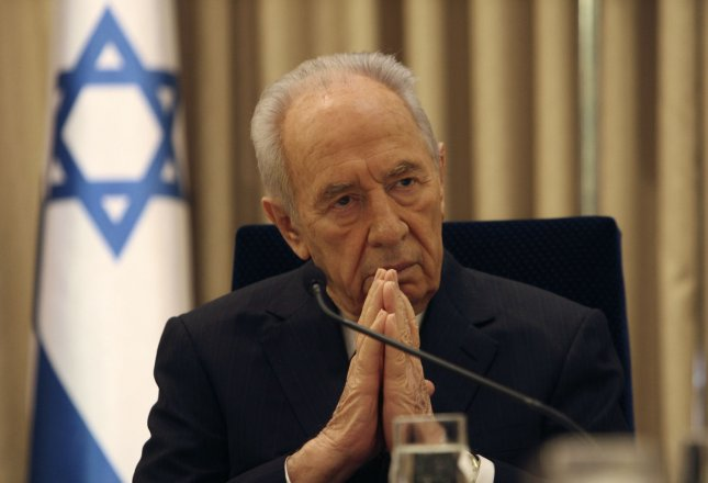 Israel's President Shimon Peres meets leader of the Yisrael Beiteinu party Avigdor Lieberman (not pictured) in Jerusalem February 19, 2009. Lieberman recommended to President Shimon Peres that he tap opposition leader Binyamin Netanyahu to try to form a government, on condition the right-wing Likud chief pursued a broad coalition. (UPI Photo/Ronen Zvulun/Pool)