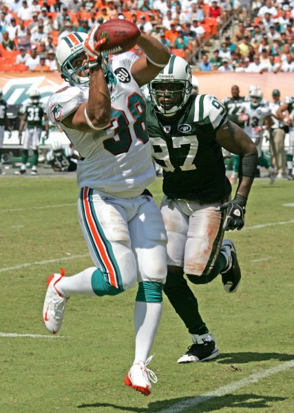 Miami Dolphins running back Patrick Cobbs catches a pass in front of New York Jets linebacker Calvin Pace in third quarter action of the season opener against the New York Jets at Dolphin Stadium in Miami on September 7, 2008. The Jets defeated the Dolphins 20-14. (UPI Photo/Martin Fried)