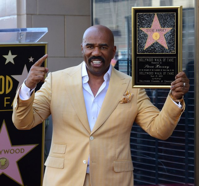 TV and radio personality Steve Harvey holds a replica plaque during an unveiling ceremony honoring him with the 2,497th star on the Hollywood Walk of Fame in Los Angeles on May 13, 2013. UPI/Jim Ruymen