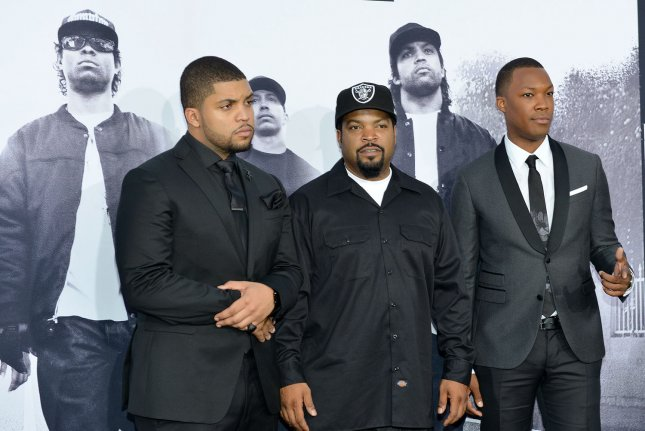 (L-R) Cast member O'Shea Jackson Jr., his father Ice Cube and actor Corey Hawkins attend the premiere of the N.W.A. motion picture biopic Straight Outta Compton at Microsoft Theater in Los Angeles on Aug. 10, 2015. Storyline. File Photo by Christine Chew/UPI