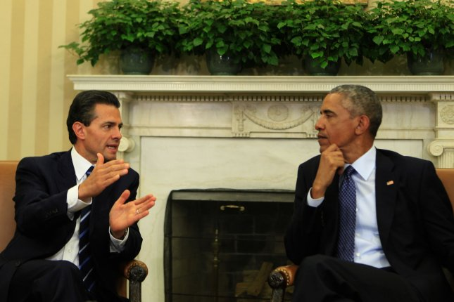 Mexican President Enrique Peña Nieto, seen here during a 2015 meeting with President Barack Obama in the White House, said Republican front-runner Donald Trump has damaged the relationship between the United States and Mexico due to his inflammatory rhetoric. File photo by Dennis Brack/Pool/UPI