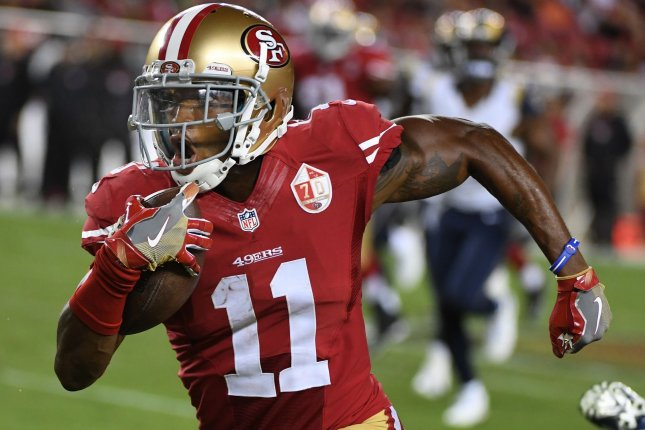 San Francisco 49ers WR Quinton Patton (11) takes a Blaine Gabbert pass 35 yards in the fourth quarter against the Los Angeles Rams at Levi's Stadium in Santa Clara, California on September 12. 2016. The 49ers defeated the Rams 28-0. Photo by Terry Schmitt/UPI