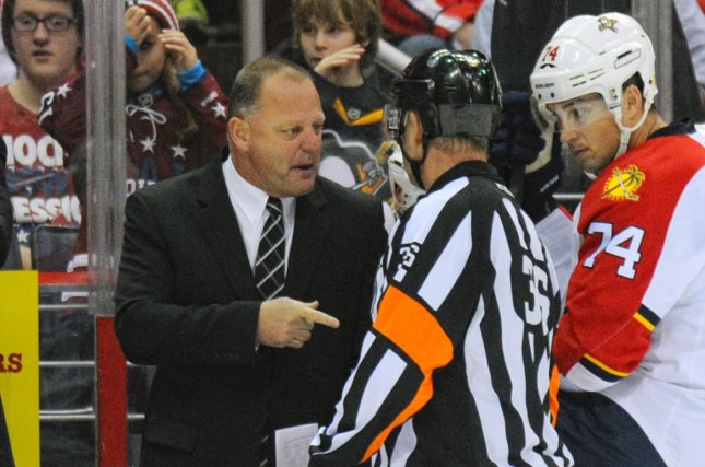 Former Florida Panthers head coach Gerard Gallant (L) has words with referee Dean Morton (36) at the bench. Gallant is expected to be announced as the new head coach of the NHL expansion team Las Vegas Golden Knights on Thursday. File photo by Mark Goldman/UPI