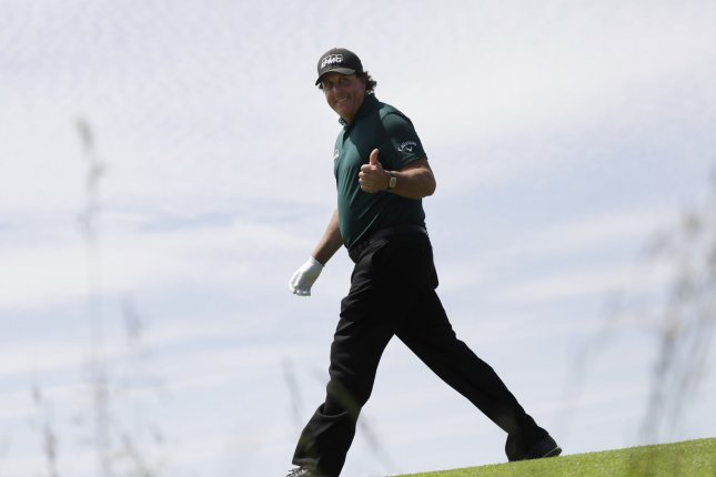 Phil Mickelson gives the thumbs up to fans on back nine in the third round at the 118th U.S. Open Championship on June 16 at Shinnecock Hills Golf Club in Southampton, N.Y. Photo by John Angelillo/UPI