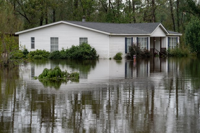 A house sits in a flooded area in Castle Hayne, N.C., as Florence, now a tropical depression, is continuing to dump rain on North and South Carolina. Photo by Ken Cedeno/UPI