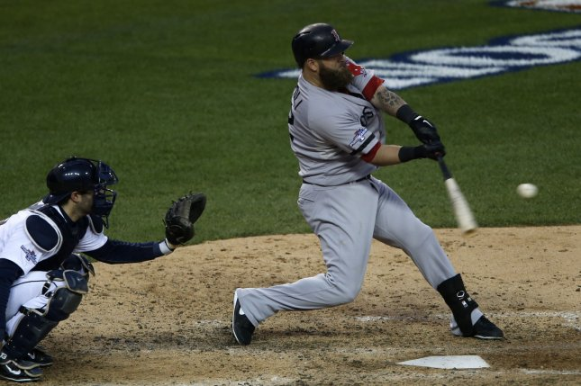 Boston Red Sox Mike Napoli hits a solo home run against Detroit Tigers during the seventh inning of Game 3 of the American League Championship Series at Comerica Park in Detroit on October 15, 2013. UPI/Rebecca Cook