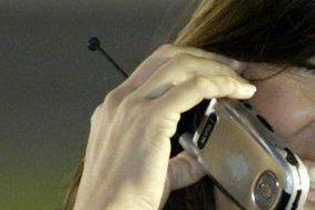 A woman talks on a cellphone (File/UPI Photo/Nell Redmond)