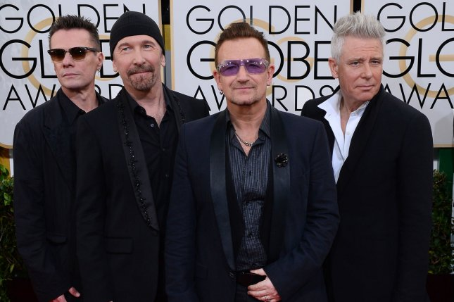 Members of the rock group U2 Larry Mullen Jr., The Edge, Bono, and Adam Clayton (L-R) arrive for the 71st annual Golden Globe Awards at the Beverly Hilton Hotel in Beverly Hills, California on January 12, 2014. UPI/Jim Ruymen