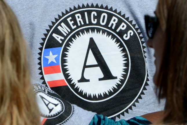 An AmeriCorps volunteer listens to President Barack Obama and President Bill Clinton speak during a ceremony to celebrate the 20th anniversary of the AmeriCorps national service program on the South Lawn of the White House on September 12, 2014. File Photo by Pat Benic/UPI