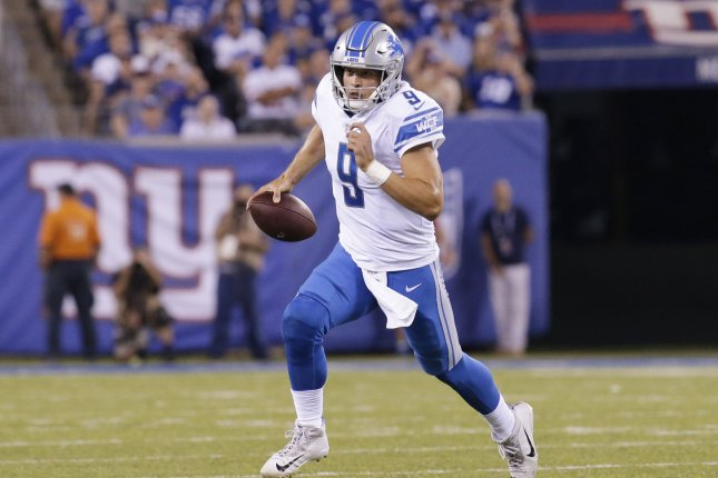 Detroit Lions quarterback Matthew Stafford scrambles with the football in the first quarter against the New York Giants in Week 2 of the NFL season on September 18 at MetLife Stadium in East Rutherford, N.J. Photo by John Angelillo/UPI