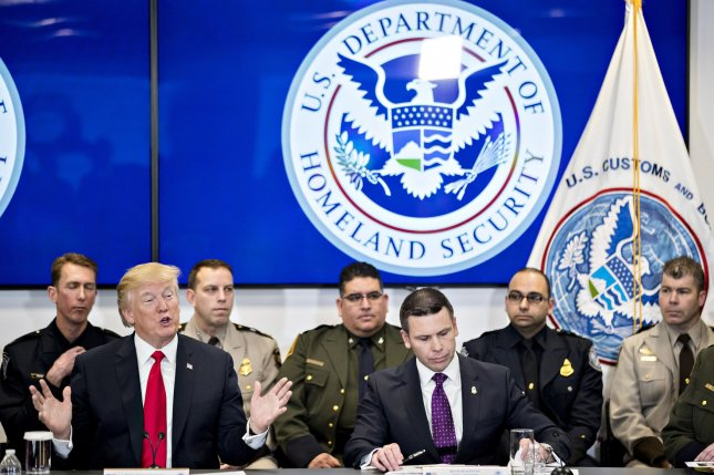 U.S. President Donald Trump (L) speaks as Kevin McAleenan, acting commissioner of the U.S. Customs and Border Protection (C) listens while participating in a Customs and Border Protection roundtable on February. 2. McAleenan appeared before the Senate judiciary committee Tuesday defending CBP agents' use of tear gas on migrants in Tijuana and lending his support for a modern border wall. File Photo by Andrew Harrer/UPI