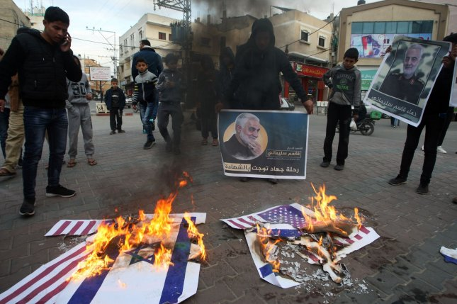 Palestinian demonstrators in the Gaza Strip burn U.S. and Israeli flags during a January 8 protest opposing the U.S.-ordered death of Iranian commander Qassem Soleimani. Photo by Ismael Mohamad/UPI