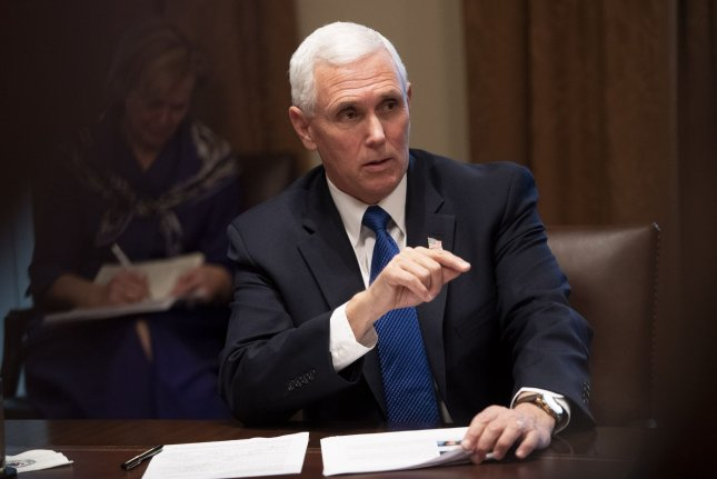 Vice President Mike Pence's press secretary said neither he nor President Donald Trump had close contact with the staffer who tested positive for coronavirus. Photo Kevin Dietsch/UPI