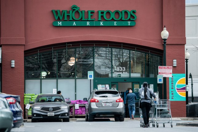 Shoppers are seen at a Whole Foods Market in Silver Spring, Md., on March 31 early in the coronavirus pandemic. File Photo by Kevin Dietsch/UPI