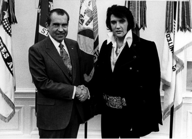President Richard Nixon (L) meets in private with Elvis Presley on December 21, 1970, at the White House. During the meeting Elvis asked if Nixon could give him an official badge from the Federal Bureau of Narcotics and Dangerous Drugs, once-secret papers revealed. Elvis told Nixon that he wanted to lend his name to the president's law enforcement initiative. In a letter to Nixon, Elvis made a pitch to be named a federal drug enforcement agent. Elvis died in Memphis on August 16, 1977. UPI File Photo