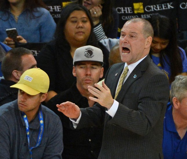 Coach Mike Malone and the Denver Nuggets fought past the Golden State Warriors on Saturday night. Photo by Terry Schmitt/UPI