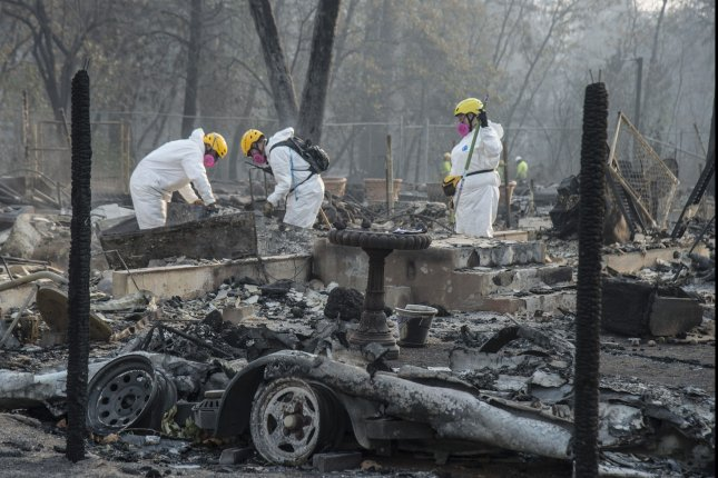 Members of the Mendocino County Sheriff's Department Search and Rescue rake through ruins in Paradise, California on November 17, 2018. The Camp Fire was California's worst and deadliest conflagration. File photo by Terry Schmitt/UPI