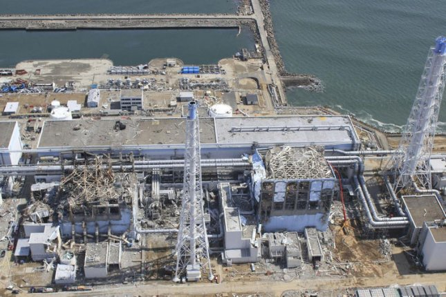 The crippled Fukushima Dai-ichi nuclear power plant in Okumamachi, Fukushima prefecture, northern Japan is seen in this March 24, 2011 aerial photo taken by small unmanned drone and released by AIR PHOTO SERVICE. UPI/Air Photo Service Co. Ltd.