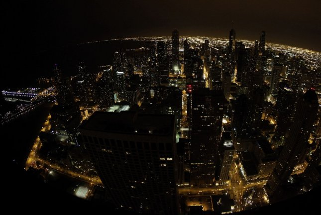 The Chicago skyline is seen from the John Hancock Center's 94th floor observatory. Sunday, Chicago police said there were more than 750 homicides in the city in 2016 -- an increase of nearly 60 percent and the biggest spike in decades. Police also recorded 1,100 more shooting incidents in 2016. File Photo by Brian Kersey/UPI