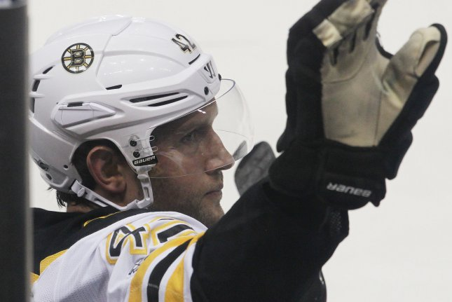 Former St. Louis Blues captain Boston Bruins David Backes, waves to the crowd after he is acknowledged and a video of his playing career in St. Louis, during a game against the St. Louis Blues in the first period at the Scottrade Center in St. Louis on January 10, 2017. Photo by Bill Greenblatt/UPI