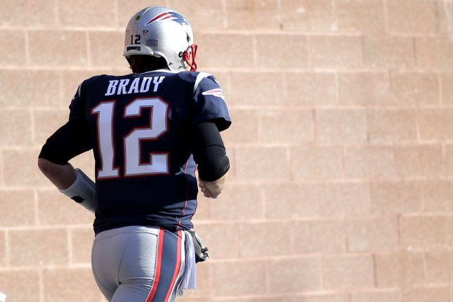 New England Patriots quarterback Tom Brady jogs on to the field for warm-ups before their 24-20 win over the Jacksonville Jaguars in the AFC Championship game on January 21 at Gillette Stadium in Foxborough Mass. Photo by John Angelillo/UPI