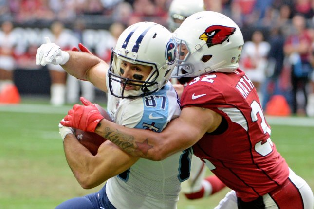 Former Tennessee Titans wide receiver Eric Decker (L) is wrapped up by Arizona Cardinals defensive back Tyrann Mathieu after a reception in the second quarter on December 10, 2017 at University of Phoenix Stadium in Glendale, Arizona. Photo by Art Foxall/UPI