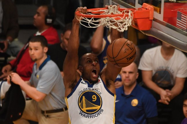 Golden State Warriors veteran Andre Iguodala managed to move around 7-footer Pau Gasol while in midair for a big dunk in the second quarter of a win against the San Antonio Spurs on Wednesday at Oracle Arena in Oakland. File photo by Jon SooHoo/UPI