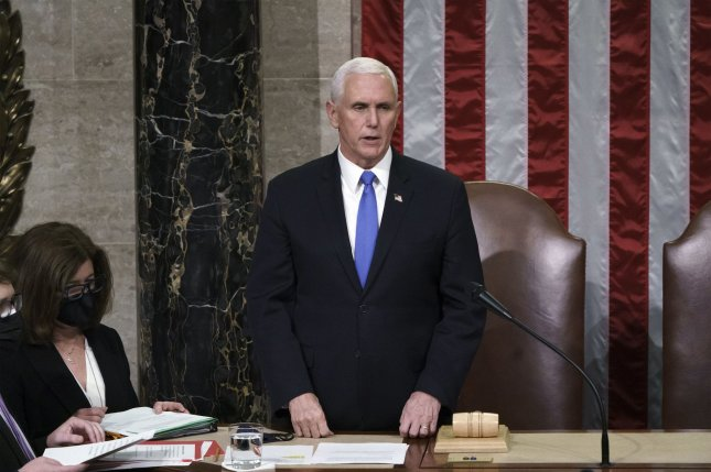 Former Vice President Mike Pence reads the final certification of Electoral College votes cast in November's presidential election during a joint session of Congress on January 7. Pence had a pacemaker installed Wednesday. File Photo by J. Scott Applewhite/UPI