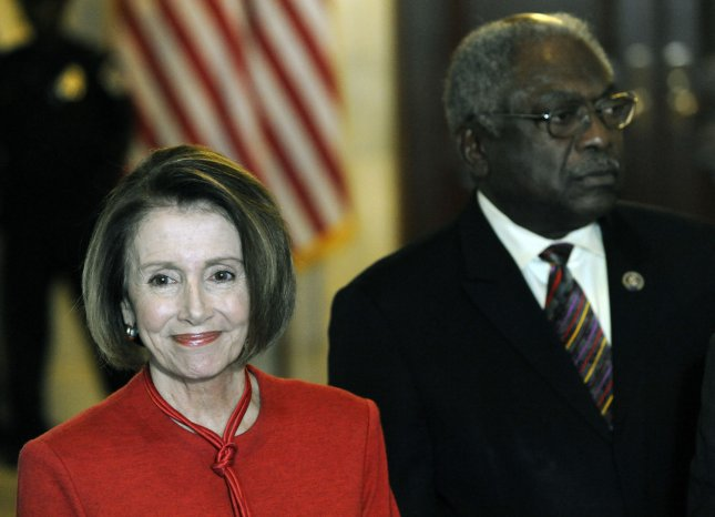 Speaker of the House Nancy Pelosi (D-CA) (L) and House Majority Whip James Clyburn (D-SC) speak to the press after a meeting with the House Democratic Caucus to push for health care legislation on Capitol Hill in Washington on November 7, 2009. UPI/Alexis C. Glenn
