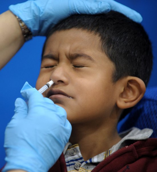 A young boy receives an inhaled H1N1 Flu vaccine dose from a nurse at Carlin Springs Elementary School in Arlington, Virginia on January 7, 2010. The virus is currently hitting hardest in Virginia, but the vaccine has now become widely available. UPI/Roger L. Wollenberg