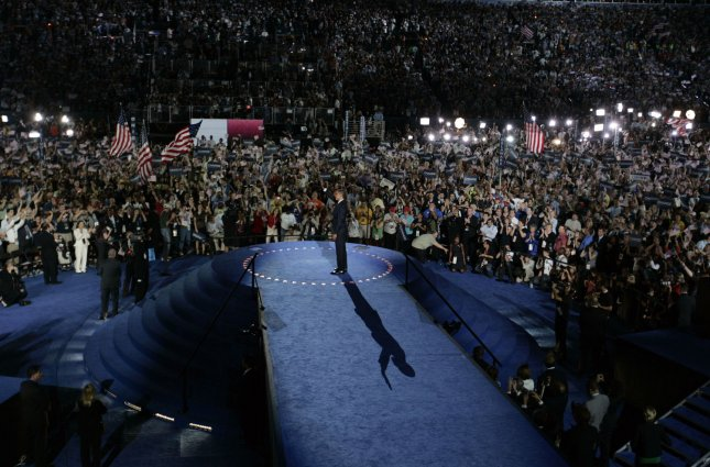 Democratic Presidential candidate Barack Obama waves after delivering his acceptance speech during on the final day of the Democratic National Convention at Invesco Field at Mile High in Denver Aug, 28, 2008. (UPI Photo/Gary Caskey)