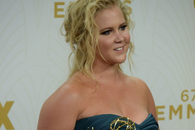 Actress/writer Amy Schumer holds her Emmy for Outstanding Variety Sketch Series for 'Inside Amy Schumer' at the 67th Primetime Emmy Awards at the Microsoft Theater in Los Angeles on Sept. 20, 2015. Schumer's rumored book has reportedly been sold to the highest bidding publishing house for somewhere between $8-10 million. Photo by Jim Ruymen/UPI