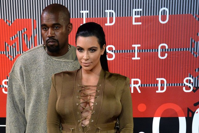 Kim Kardashian (R) and husband Kanye West at the MTV Video Music Awards on August 30. The reality star received 150 gifts from West for Christmas. File Photo by Jim Ruymen/UPI