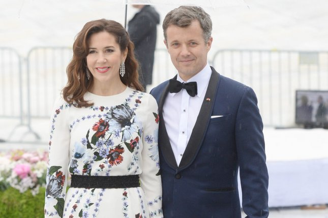 Prince Frederik (R), pictured with Princess Mary, rushed home to Denmark amid news Prince Henrik's health has greatly deteriorated. File Photo by Rune Hellestad/UPI