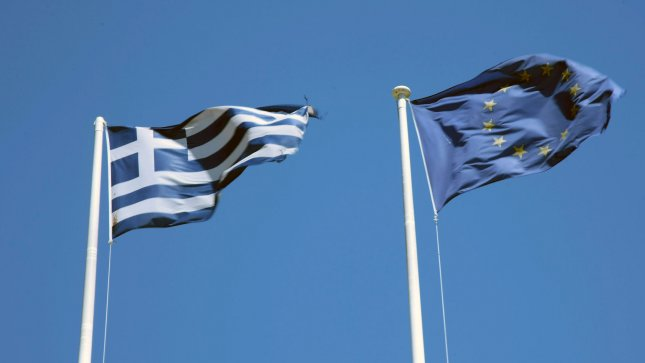 A Euro flag flaps next to a Greek flag on the day New Democracy leader Antonis Samaras is forming a new government in Athens Greece,on Wednesday June 20,2012.Mr.Samaras's is today meeting leaders from other parties to form a coalition government. UPI/Hugo Philpott