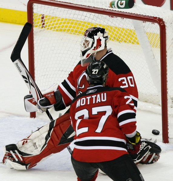 bc9959dcd New Jersey Devils Mike Mottau watches the game winning puck shot by Carolina  Hurricanes Eric Staal go by Martin Brodeur (30) in the third period of game  ...